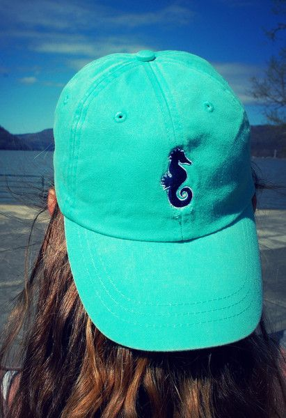 """Our pigment dyedhat is embroidered with our signature seahorse on the front and the words """"Coral Grace"""" across the back--it's the perfect piece for a day at the beach!   Pigment dyedSeafoamColor 100% Cotton Baseball Cap Features embroidered seahorse on front and """"Coral Grace""""on back AdjustableTuck-away leather back strap with antiqued brass buckle clasp Embroidered in the USA!  A PORTION OF EACH SALE GOES TO HELP SAVE THE CORAL REEFS!"""