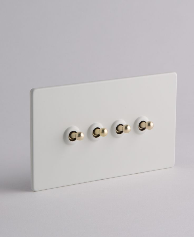 Our toggle light switch 4 toggle white & gold is a quadruple toggle switch in white satin with gold toggles. Has concealed fittings and is LED compatible.