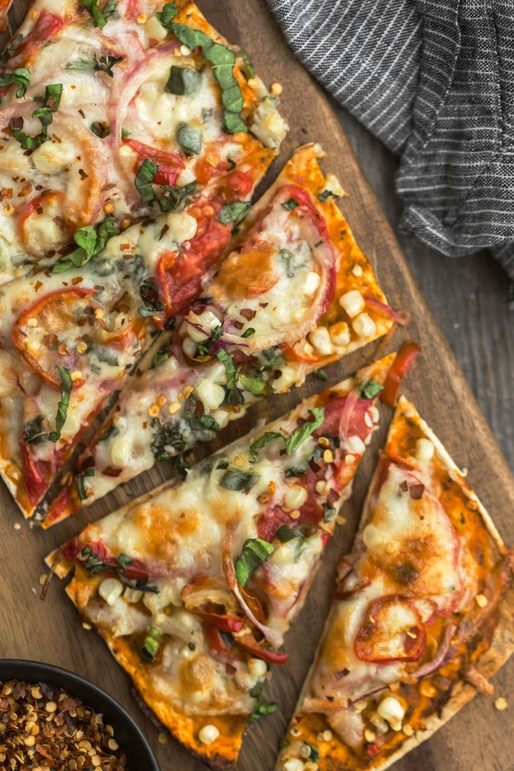 I especially love this flatbread because thanks to the cooking time, all the vegetables can be tossed on raw and will soften/cook while the cheese is melting. This recipe is also great for adding any and all herbs you might have growing in your garden!
