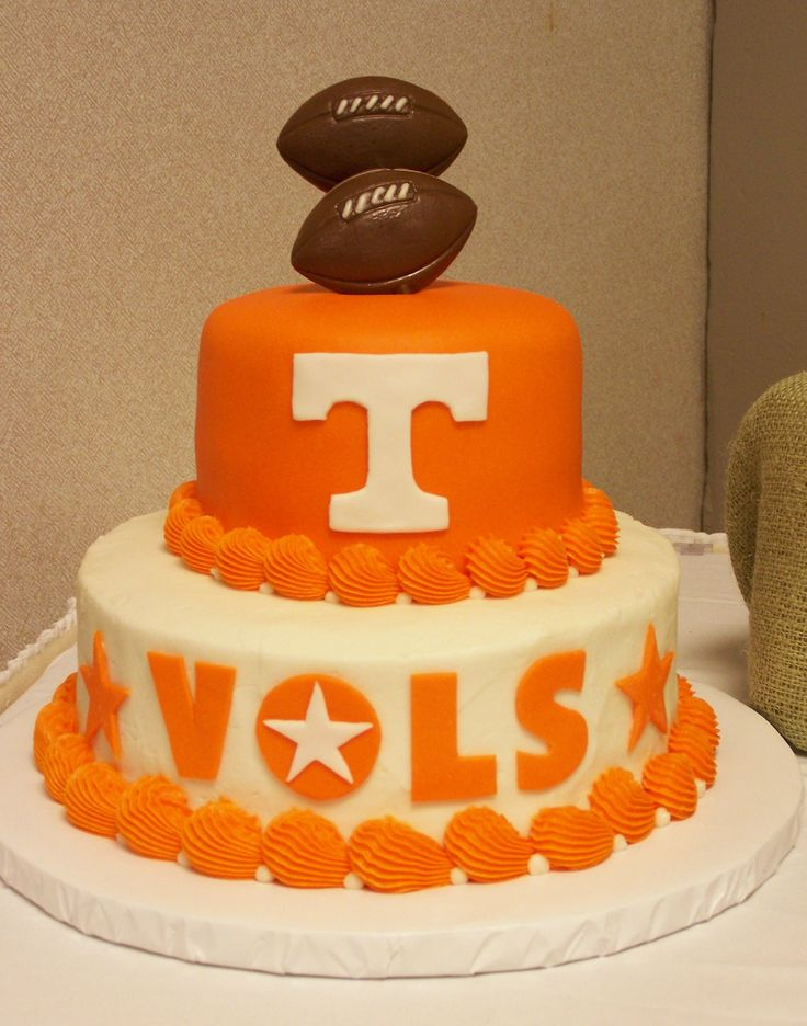 TN cake-decorator icing with fondant letters and candy footballs