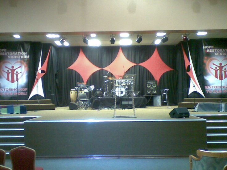 Church stage decor, draping in red stretch panels on black backdrop