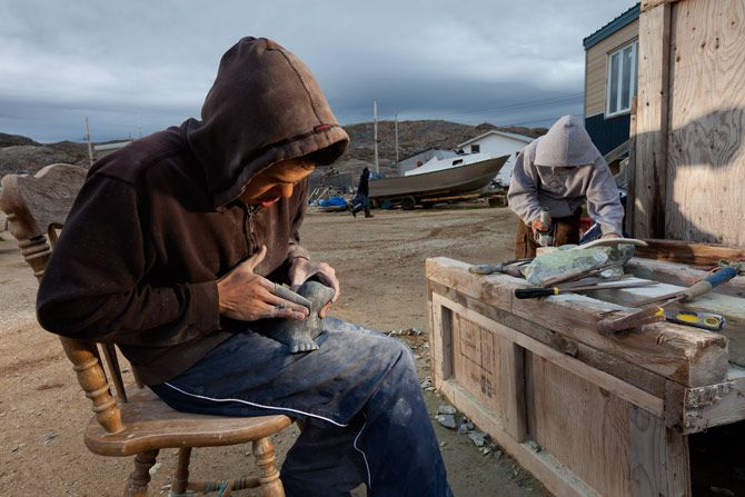 """""""Mosesie Kolola finishes up a soapstone carving of a seal. Like many Inuit artisans in the small Baffin Island village of Kimmirut, Kolola sells his crafts to the local co-op store, a modern-day trading post."""" http://ngm.nationalgeographic.com/2012/11/vikings-and-indians/coventry-photography#/08-mosesie-kolola-finishes-soapstone-carving-670.jpg"""