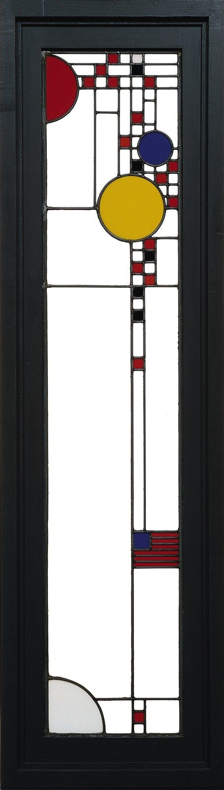Frank Lloyd Wright (1867-1959) - Leaded Glass Window. Coloured and Translucent White Glass with Zinc Came and Wood Frame. Designed for the Avery Coonley Playhouse, Coonley Residence, Riverside, Illinois. Executed by Linden Glass Company, Chicago, Illinois. Circa 1912. 154.8cm x 31.7cm.
