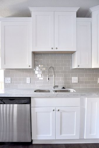 Love the grey subway tile with the white cabinets and white/grey countertops - perfect combination.. subway tile with tie in with my brick throughout house