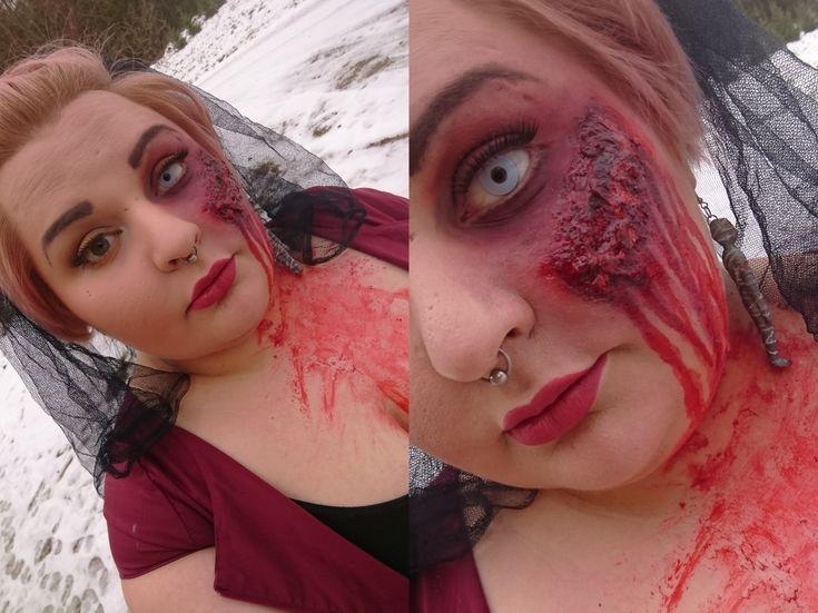 Halloween makeup. Contact lense, bruised eye, wound, fake skin, fake blood.