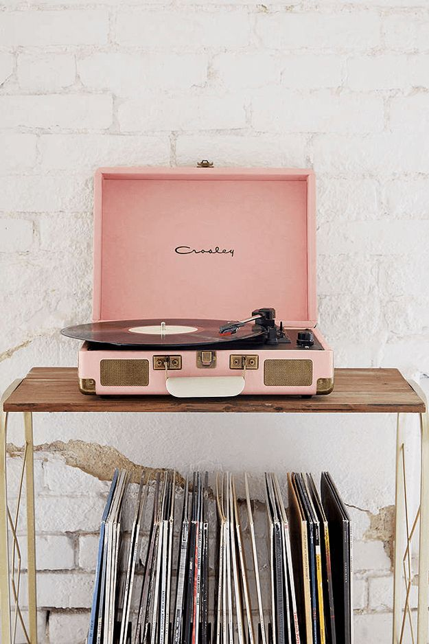 dusty pink vinyl record player, pantone pale dogwood, rose quartz, dusty peach, dusty rose, blush pink, blush rose, salmon pink, white brick wall