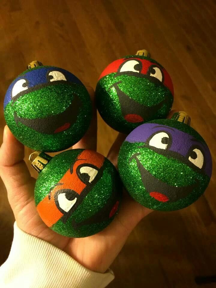 Ninja Turtle Glitter Ornaments: Paint Mod Podge onto the ornaments. Then, over a plate or bowl, pour the glitter on top of the Mod Podge, and shake off the excess. Let sit to dry. Then paint. :)