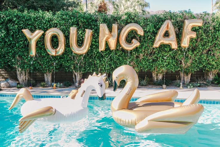 how to throw a pool party, funboy pool floats, inflatable swan