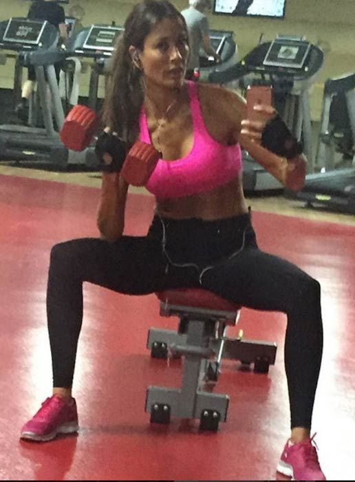 Melanie Sykes doing bicep curls in the gym...