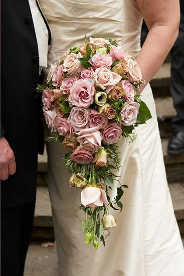 A luxurious trailing teardrop shaped bouquet of premium roses, including sweet avalanche, memory lane, quicksand and old dutch roses. plus pretty lisianthus and anemones The bouquet will be designed in a specialist oasis holder to create this very pretty shape.  The handle bound with pretty cream ribbon. pollen flowers brighton