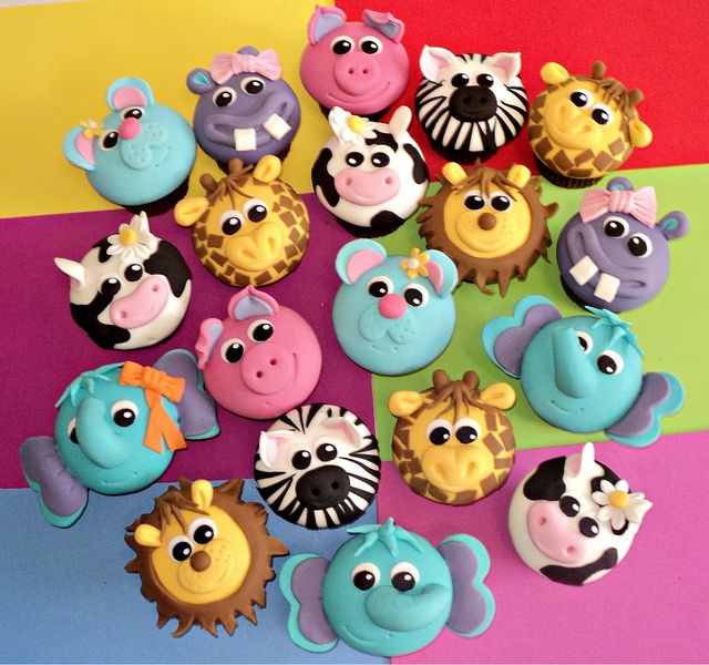 Variety of cartoon animal cupcakes.
