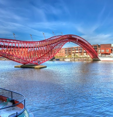 Extraordinary red steel bridges located in Amsterdam, and extending over the water between the islands Sporenburg and Borneo.