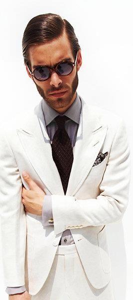 Crisp in Tom Fords's white suit..