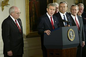 U.S. President George W. Bush speaks before signing the congressional resolution authorizing U.S. use of force against Iraq if needed during a ceremony in the East Room of the White House October 16, 2002. With President Bush is Vice President Dick Cheney (L), Speaker of the House Dennis Hastert (obscured), Secretary of State Colin Powell (3rd R), Secretary of Defense Donald Rumsfeld (2nd R) and Sen. Joe Biden (D-DE).