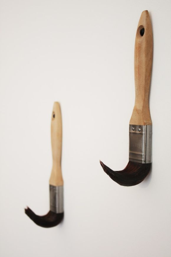 Coat hangers made from old paint brushes, genius!