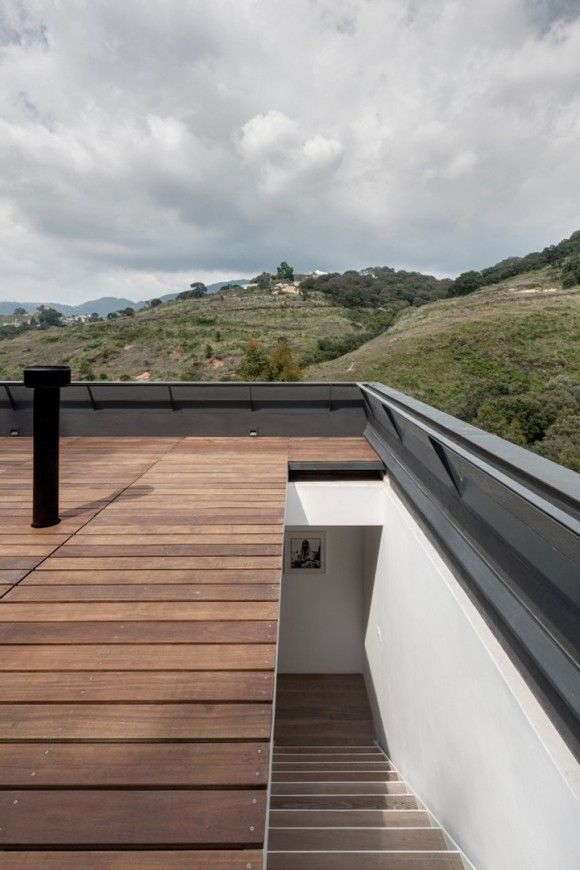 stairs into/through skylight to access roof deck. alta-house-asd-architecture