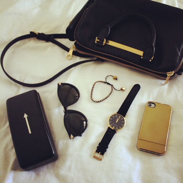 Keepin it simple in black and gold: Marc by Marc Jacobs bag, Karen Walker sunglasses, Larsson & Jennings watch, Vanessa Mooney bracelet and Incase iPhone cover