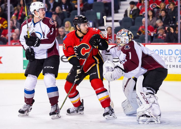 18 March 2016: Colorado Avalanche Defenceman Chris Bigras (3) [10099], Calgary Flames Right Wing Freddie Hamilton (25) [7973] and Colorado Avalanche Goalie Semyon Varlamov (1) [5536] in action during an NHL Hockey game between the Calgary Flames and the Arizona Coyotes at the Scotiabank Saddledome in Calgary, AB. (Photo byÊJose Quiroz/Icon Sportswire)