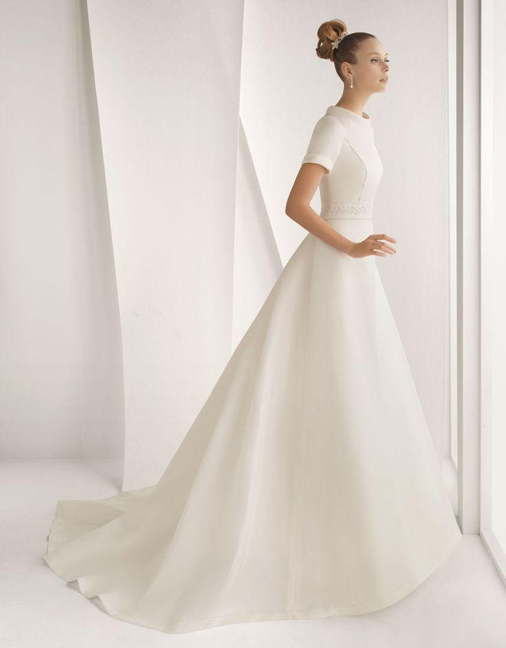 AIXA - Vestido de novia en organza mikado con adorno de pedrería en color marfil.