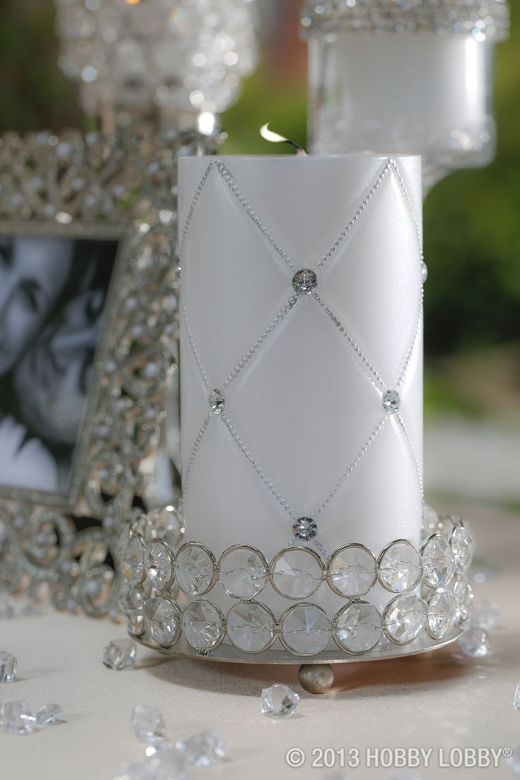This White Diamond Pattern Pillar Candle is unscented and great for any wedding decor. The candle features a beaded diamond pattern accented with large clear rhinestones.