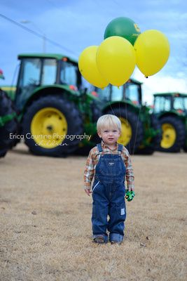 2nd Birthday Portraits for a Boy- Take him to a John Deere dealership. I took these pictures of my son when he turned two because he loves tractors. The people at the dealership were so sweet and even gave him John Deere balloons to hold.