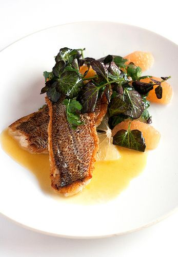 Crispy yellowtail snapper with purple water cress and citrus.