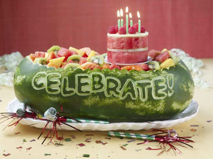 WATERMELON WITH A TINY WATERMELON BIRTHDAY CAKE AND THE WORD CELEBRATE CARVED