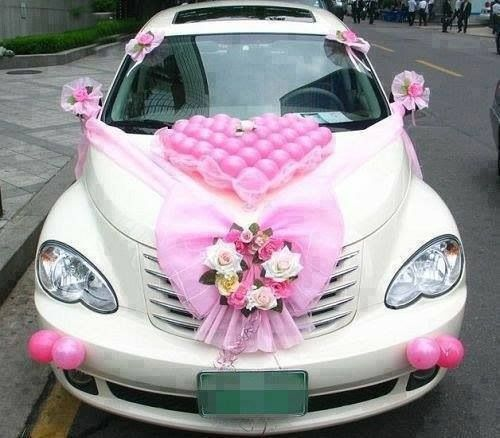 Car decorated with flowers and hearts to show off the bride and groom after the wedding...