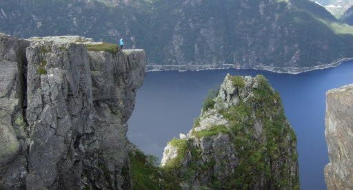 Skomakarnibbå -The shoemaker's needlepoint- in Hjelmeland. Preikestolen is a walk in the park compared to this hidden plateau.   Legend has it that a shoemaker lost a bet with the devil and had to make a pair of shoes while sitting on this rocky outcrop. He got distracted by a wedding procession sailing in the fjord below, lost his balance and fell down into the fjord. It is said that when the Seven Sisters marry, Skomakarnibbå will come crashing down into the fjord.