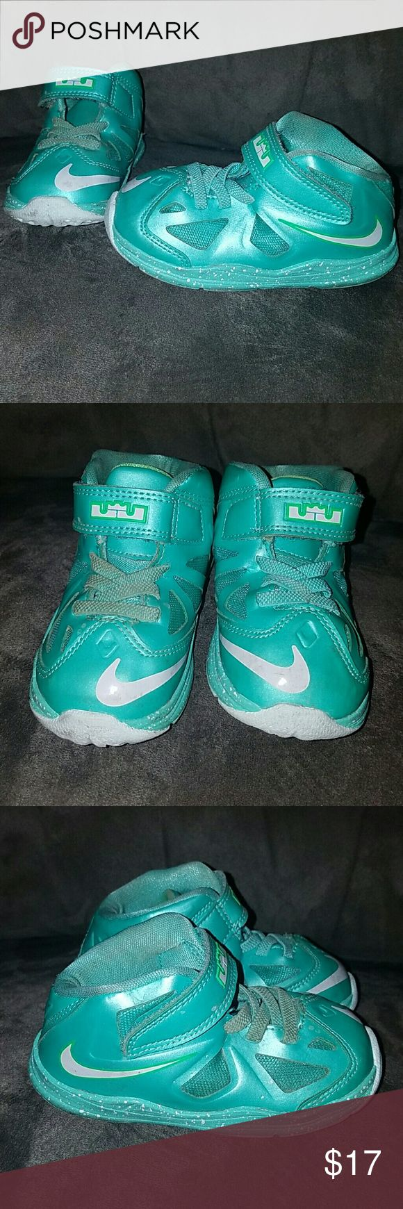 Size 7c baby/ toddler LeBron James/ Nike shoes Aqua colored size 7c unisex LeBron James gym shoes. Really good condition. Bottom of shoes look almost new. My daughter wasn't even walking when these were her size! Super fun color and great for any stylish little cutie! Nike Shoes Baby & Walker