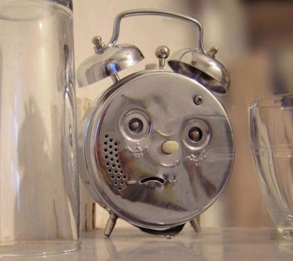 """Alarm clock face. """"Why are you mad? You told me to wake you up!"""""""