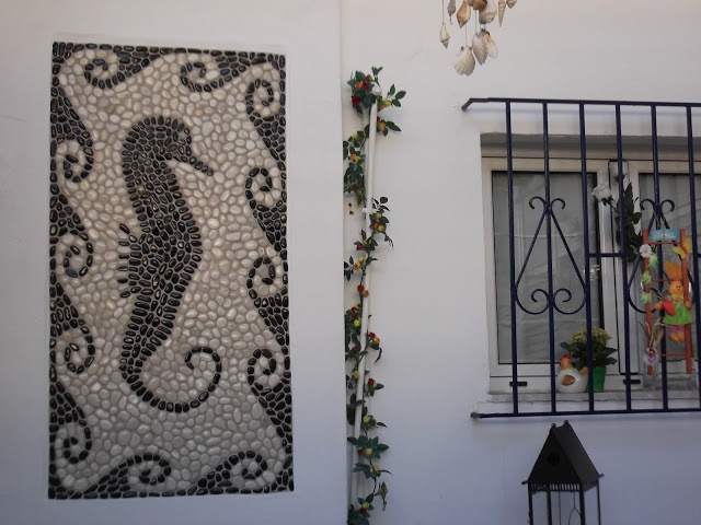 Pebble mosaic installed on wall, more of my art: https://www.facebook.com/Votsalotos  Feel welcome and see if you like it. Thank you Nikolas Asvestas.