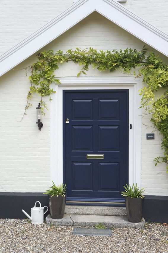 A Grand Entrance With A Wide Front Traditional 6 Panel Front Door.