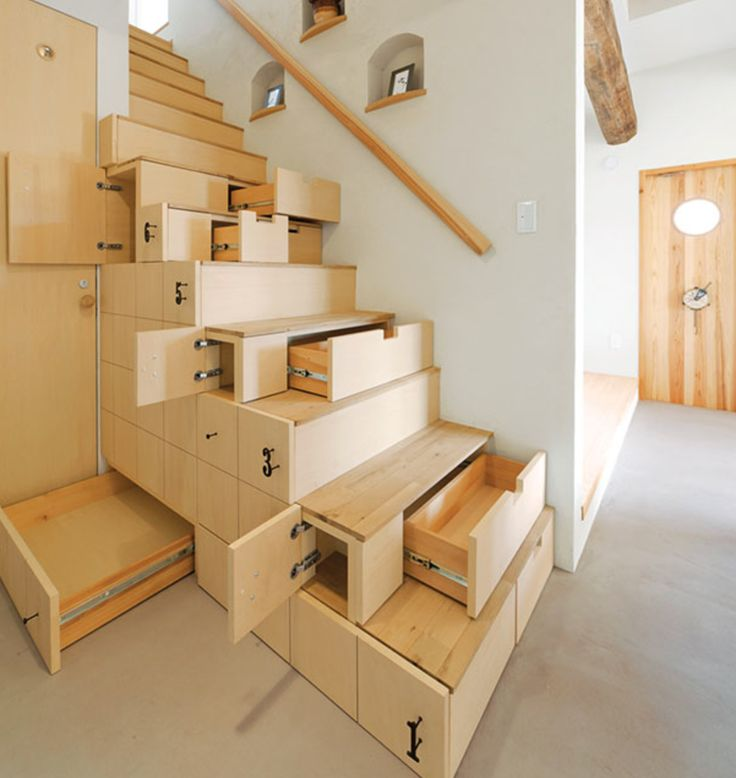 wicked space saving stairs with plenty of storage space.