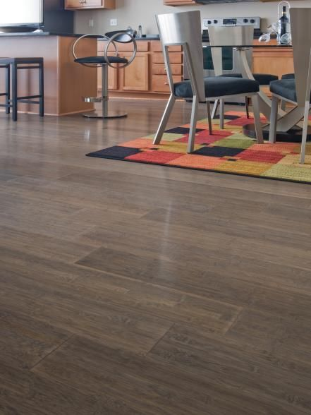 Wide-plank engineered bamboo flooring adds a contemporary look to a luxury apartment. The 7 ½-inch wide planks, in an antique bronze hue, are also a practical, durable choice. Photo courtesy of DuroDesign Flooring, Inc.