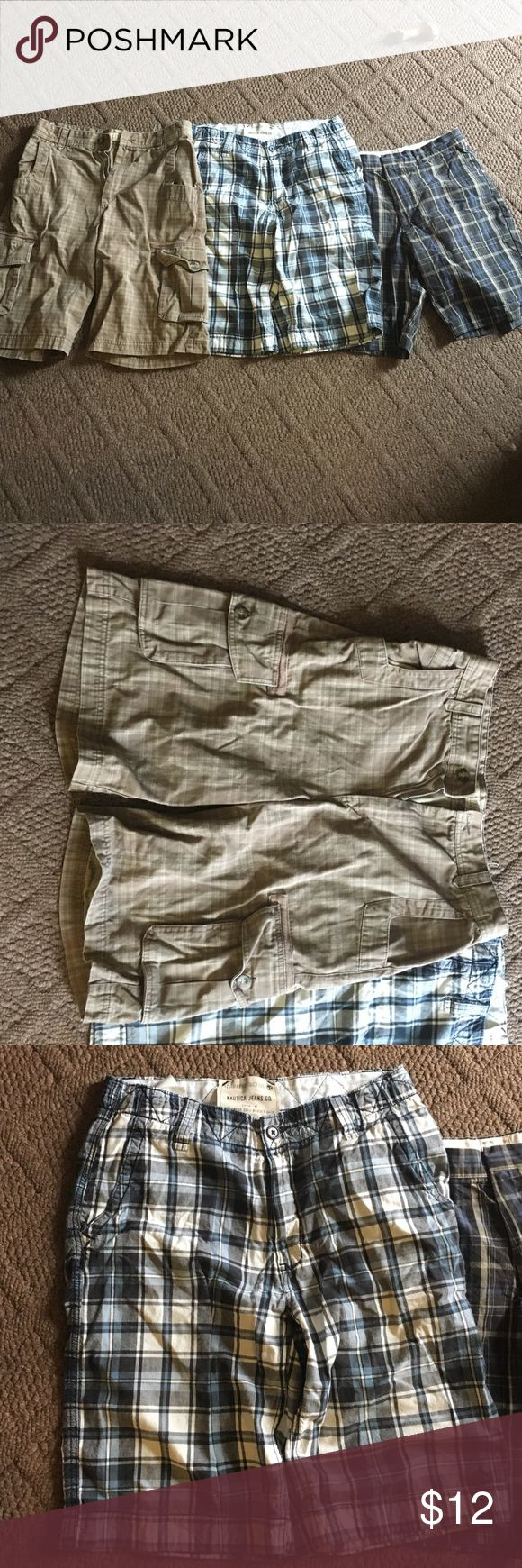 Three Pair of Men's Plaid Shorts From left to right: Cabela's 32W brown plaid, Nautica 32W navy and white plaid, Docker's 32W black and blue plaid. All gently worn. Dockers Shorts Cargo