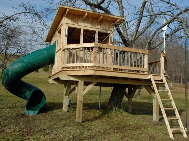 Located in an old apple orchard, this Vermont treehouse from  Vermont Treehouse Company  is made of red cedar and features a drawbridge ladder, fire pole, flag pole, Dutch door with peephole, mail slot, tube slide and table with tree stump chairs. There's also a bucket crane so the kids can haul apples up into the treehouse and a chute so they can roll them down into the family apple press.