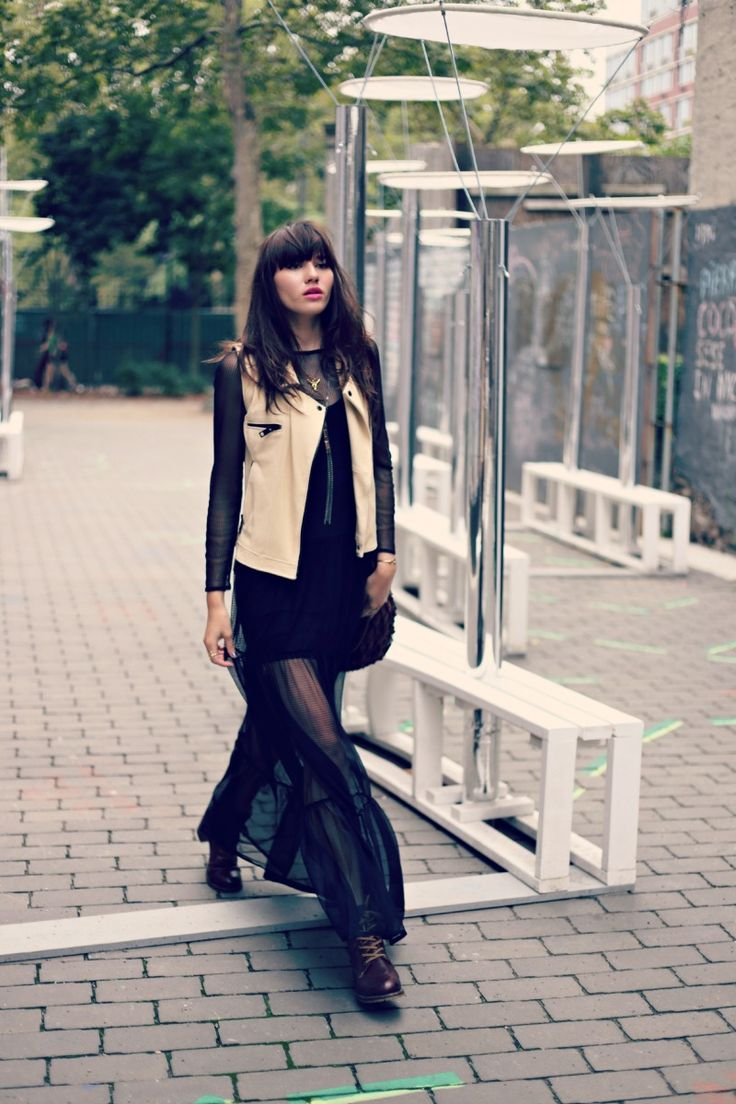 Black sheer long sleeve dress with a leather vest. Love the look from Natalie Off Duty.