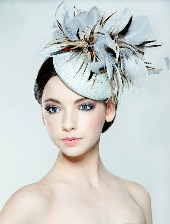 Light blue straw percher hat with feather trim perfect for weddings or races.