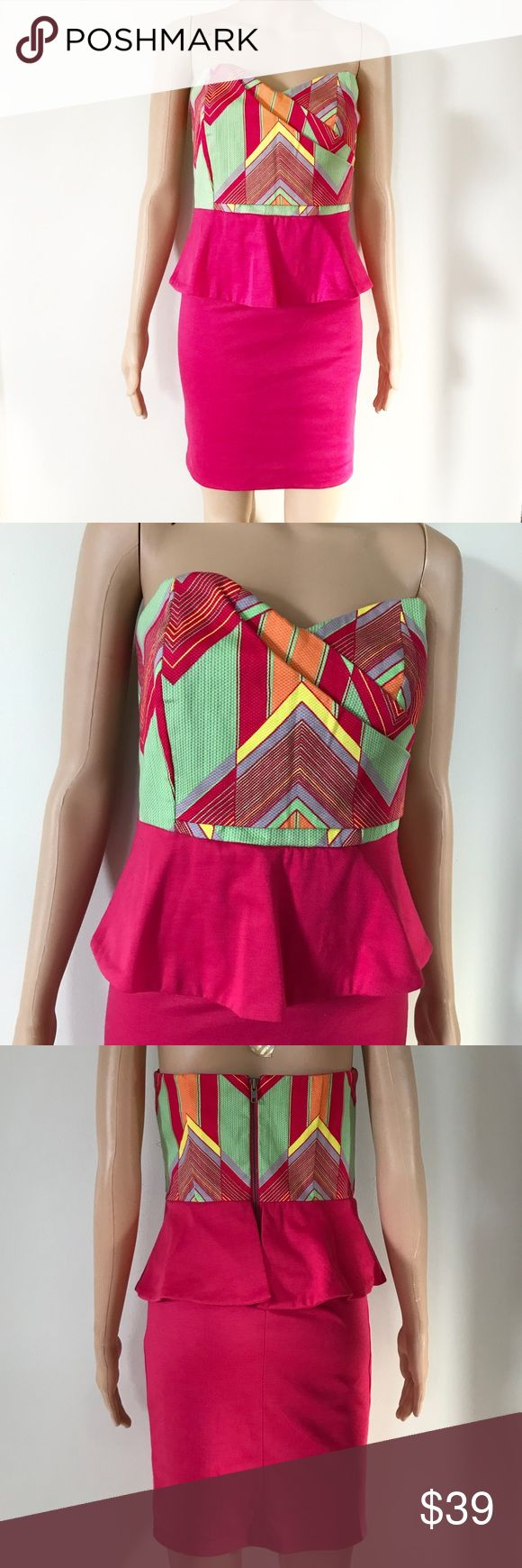 "Judith March Strapless Zig Zag Peplum Dress Judith March Coastal Zig Zag aztec strapless peplum dress. Super cute party dress! • Excellent condition, like new • Asymmetrical sweetheart neckline • Hot pink / fuchsia colors with lime green, orange, and yellow • Zip Up closure  • Cotton spandex blend, skirt has good stretch • Style 728D-1  • Approx. measurements when laid flat: 32"" bust, 28"" Waist, 25.5"" length Judith March Dresses Mini"