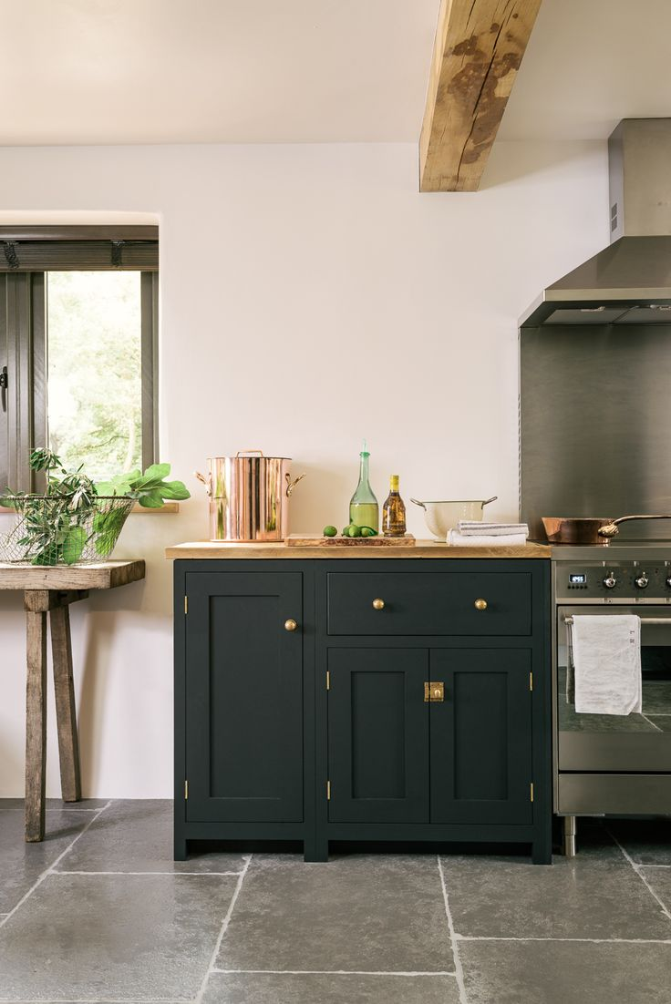 Pantry Blue deVOL Shaker cabinets, brass door furniture and a beautiful Worn Grey Limestone flooring from our sister company @floorsofstone