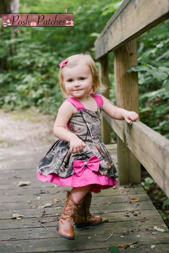 Love CAMO? Then this dress is perfect for your little hunting princess! Realtree Camo is the main fabric for this dress paired with pink accents for
