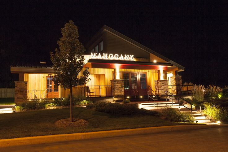 A night shot of a low maintenance deck on a builders display center in Ottawa.