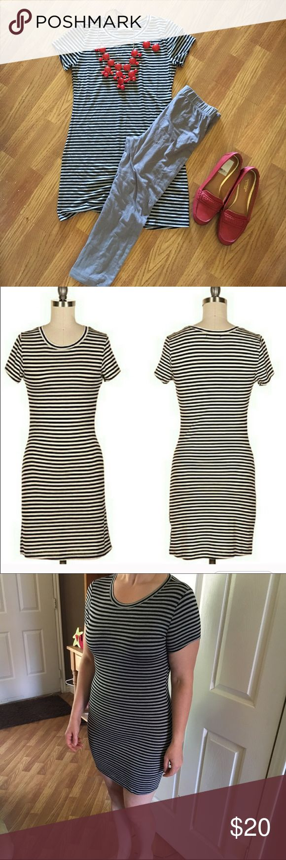 Black and gray striped mini dress/tunic Made with buttery soft material that is super stretchy made with 96% rayon and 4% spandex.  Form fitting. Pairs great with some sexy red heels or with leggings and a pair of flats.  These are Brand new with out tags. Fashionomics.  Dresses Mini