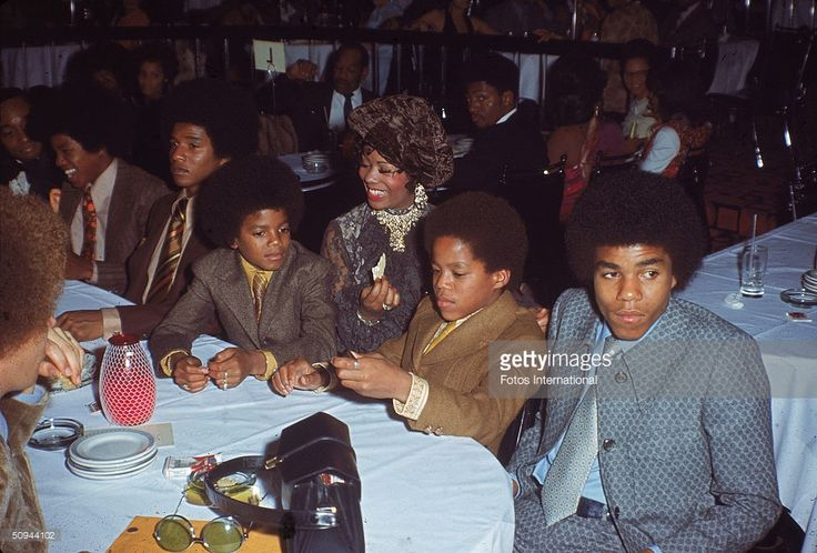 The Jacksons attend the NAACP Image Awards, Los Angeles, California, November 19, 1970. From right, Tito Jackson, Marlon Jackson, unidentified woman, Michael Jackson, Jackie Jackson, and Jermaine Jackson.