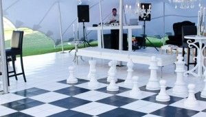 Stunning black and white dance floor built into a white floor and used as a chess set at Val de Vie