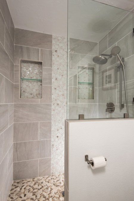 pebble tile floor in walk-in shower