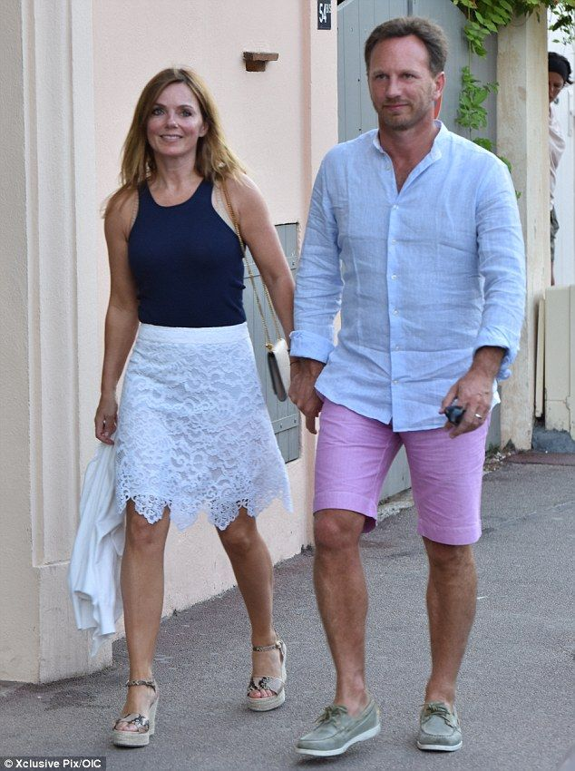 Riviera nights: Geri Halliwell and her new husband Christian Horner enjoy an evening strol...
