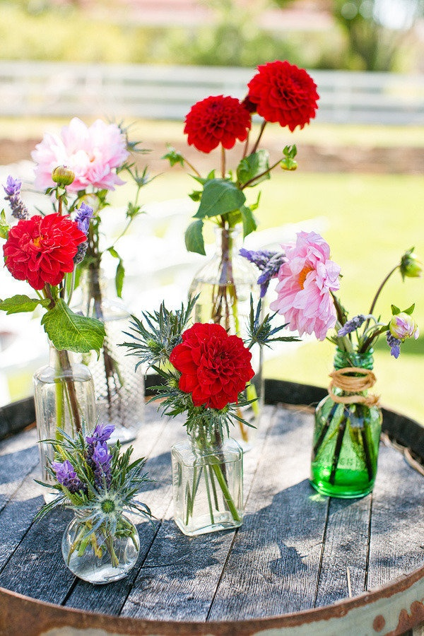Loving this mix of eclectic vases and single blooms. Photography by jen-rodriguez.com, Floral Design by aprilflowersslo.com