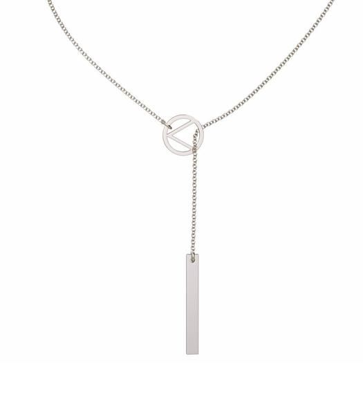 """LIBERTI - Love Lariat Necklace. This necklace features the """"<"""" symbol to honour and raise awareness of the millions of refugees confined to live on camps. Minimalist design and perfect for everyday wear. Handcrafted in the USA from ethically sourced, non-toxic, nickel-free and quality metals. Colour/Material: Sterling Silver chain (24"""") and guaranteed to never tarnish."""